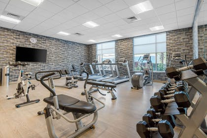 Exercise room with cardio equipment and weights | Cambria Hotel Mount Pleasant – Charleston