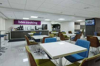 Breakfast Area | hom hotel + suites, Trademark Collection by Wyndham