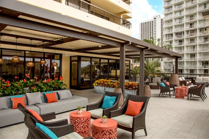 Aston Waikiki Beach Tower - 4th Floor Deck Seating Area | Aston Waikiki Beach Hotel