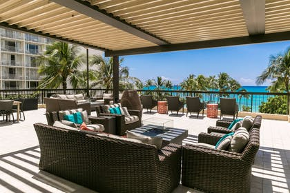 The Residences at Waikiki Beach Tower - 4th Floor Deck Seating Area | Aston Waikiki Beach Tower