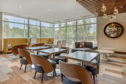 Enjoy breakfast in this seating area   Cambria Hotel Charleston Riverview