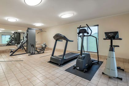 Exercise room with cardio equipment | Rodeway Inn