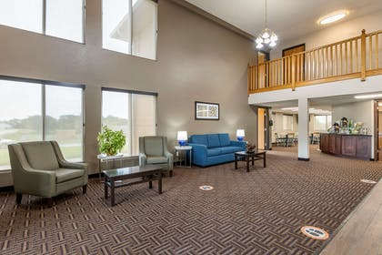 Lobby with sitting area | Rodeway Inn