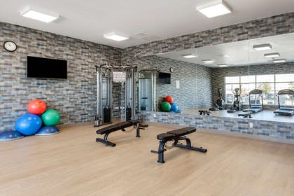 Exercise room with cardio equipment and weights | Cambria Hotel Richardson-Dallas