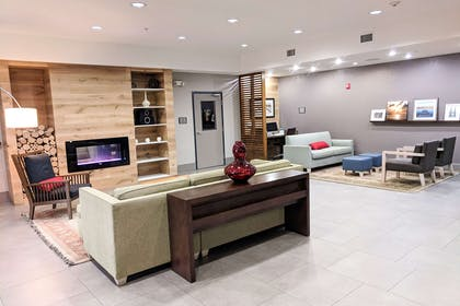 Spacious lobby with sitting area | Comfort Inn & Suites