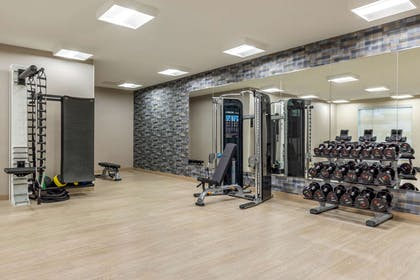 Exercise room with cardio equipment and weights   Cambria Hotel Milwaukee Downtown