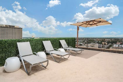 Relax by the pool   The Marquee, an Ascend Hotel Collection Member