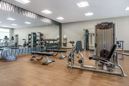 Exercise room with cardio equipment and weights | Cambria Hotel Fort Mill