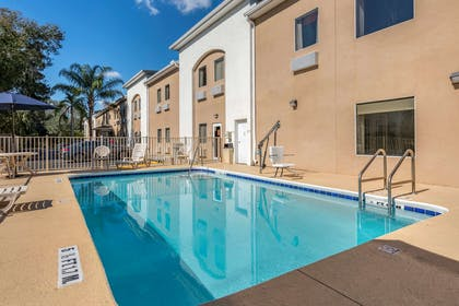 Relax by the pool | Quality Inn