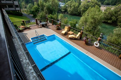 Relax by the pool | The Pine Lodge on Whitefish River, Ascend Hotel Collection