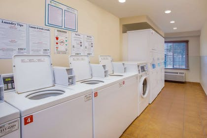Guest laundry facilities | WoodSpring Suites Mobile