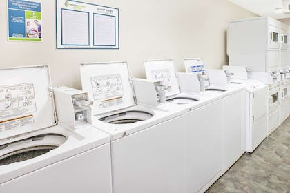 Guest laundry facilities | WoodSpring Suites Grand Rapids Holland