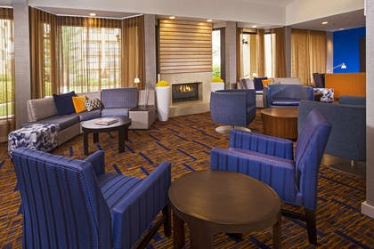 Lobby fireplace | Courtyard by Marriott Charlotte University Research Park