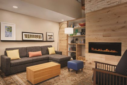 Living Room with Fireplace | Country Inn & Suites by Radisson, Lawrenceville, GA