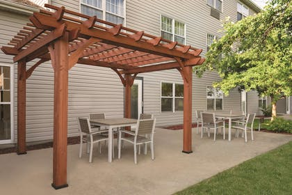 Outdoor Seating Area | Country Inn & Suites by Radisson, Pella, IA