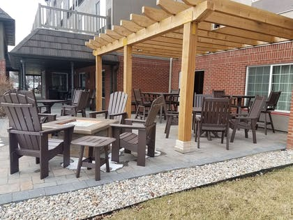 Veranda with Firepit | Country Inn & Suites by Radisson, Indianapolis Airport South, IN