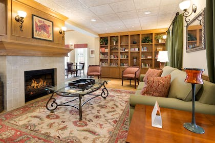Lobby with Fireplace | Country Inn & Suites by Radisson, Covington, LA