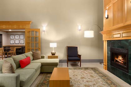 Lobby With Fireplace | Country Inn & Suites by Radisson, Rochester South, MN