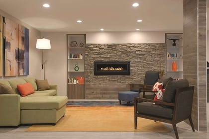 Living Room With Fireplace | Country Inn & Suites by Radisson, Shoreview, MN
