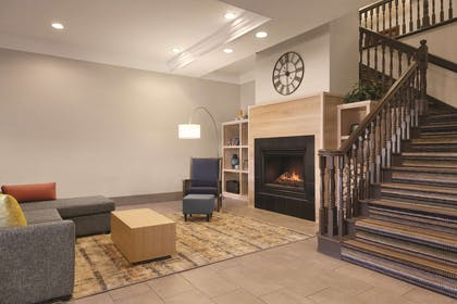 Lobby with Fireplace | Country Inn & Suites by Radisson, Billings, MT