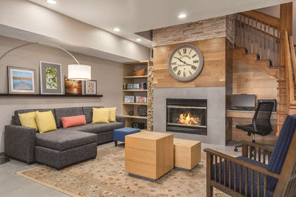 Living Room With Fireplace | Country Inn & Suites by Radisson, Big Flats (Elmira), NY