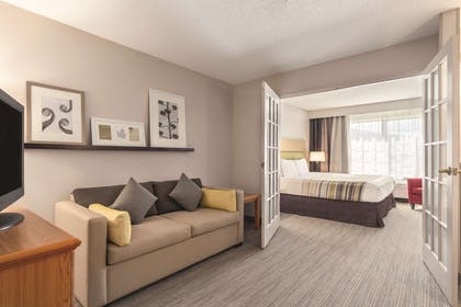 Bedroom Suite | Country Inn & Suites by Radisson, Big Flats (Elmira), NY
