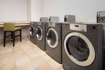 Laundry | Country Inn & Suites by Radisson, Houston Intercontinental Airport Eas