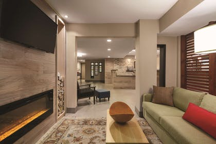 Living Room With Fireplace | Country Inn & Suites by Radisson, Bakersfield, CA