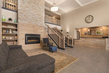 Living Room with Fireplace   Country Inn & Suites by Radisson, Detroit Lakes, MN