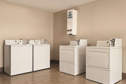 Guest Laundry | Country Inn & Suites by Radisson, Erlanger, KY - Cincinnati Airport