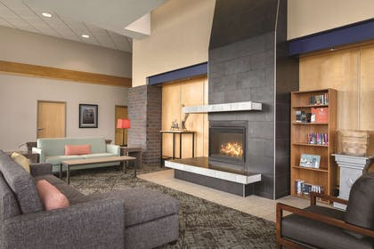 Lobby With Fireplace | Country Inn & Suites by Radisson, Fergus Falls, MN
