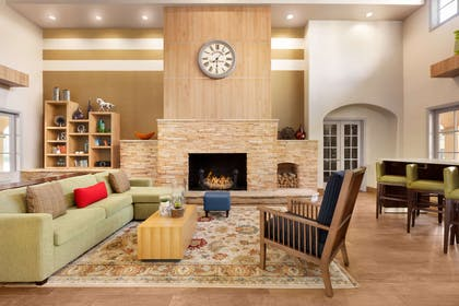 Living Room Fireplace | Country Inn & Suites by Radisson, John Wayne Airport, CA