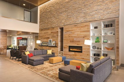 Living Room With Fireplace | Country Inn & Suites by Radisson Lawrence