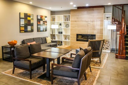 Lobby Seating and Fireplace | Country Inn & Suites by Radisson, Washington Dulles International Airp