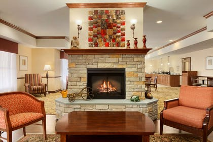 Living Room With Fireplace | Country Inn & Suites by Radisson, Ashland - Hanover, VA