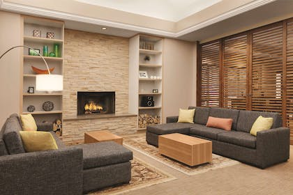 Living Room With Fireplace | Country Inn & Suites by Radisson, Seattle-Bothell, WA