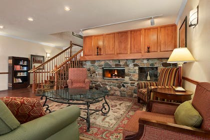 Living Room with Fireplace | Country Inn & Suites by Radisson, Stevens Point, WI