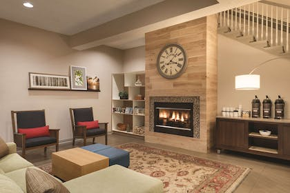 Lobby Area with Fireplace | Country Inn & Suites by Radisson, West Bend, WI