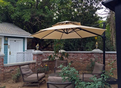 Patio | Americas Best Value Inn & Suites Royal Carriage