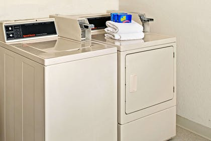 Guest Laundry | Super 8 by Wyndham Omaha Eppley Airport/Carter Lake