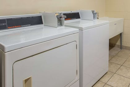 Laundry | Days Inn & Suites by Wyndham Navarre Conference Center