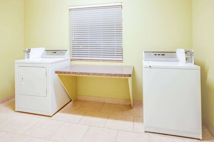Laundry | Days Inn & Suites by Wyndham Russellville
