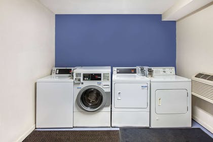 Laundry | Days Inn & Suites by Wyndham Braunig Lake