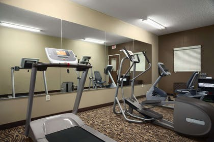 GymFitness Room | Microtel Inn & Suites By Wyndham Fairmont