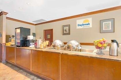 Breakfast Area | Days Inn and Suites by Wyndham St. Louis/Westport Plaza