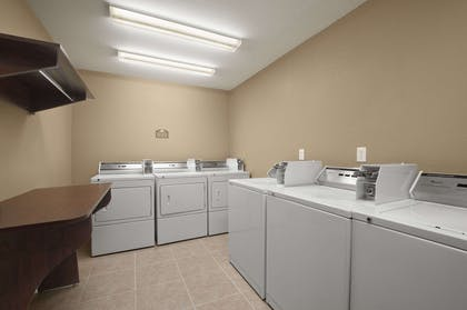Laundry Room | Microtel Inn & Suites by Wyndham Gonzales
