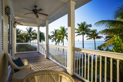 Four bedroom cottage balcony | Sunset Key Cottages