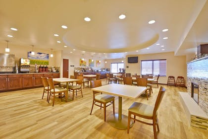 Breakfast Seating Area | Best Western Plus Green Mill Village Hotel & Suites
