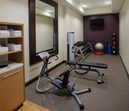 Health club fitness center gym | DoubleTree Suites by Hilton Bentonville