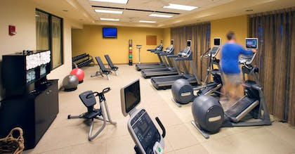 Health club fitness center gym | Embassy Suites by Hilton East Peoria Riverfront Hotel & Conference Center